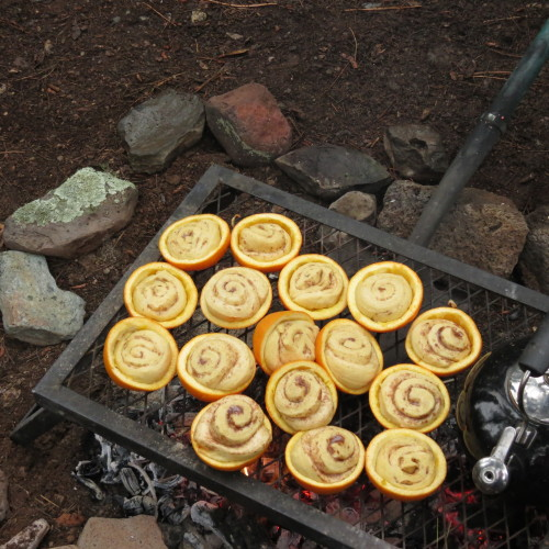 campfire breakfast orange rolls cooked in oranges