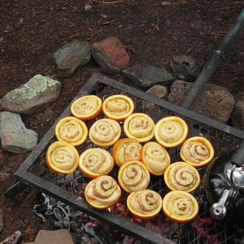 campfire breakfast orange rolls cooked in oranges